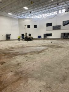 Subfloor of ice rink in the process of removal for new rink.
