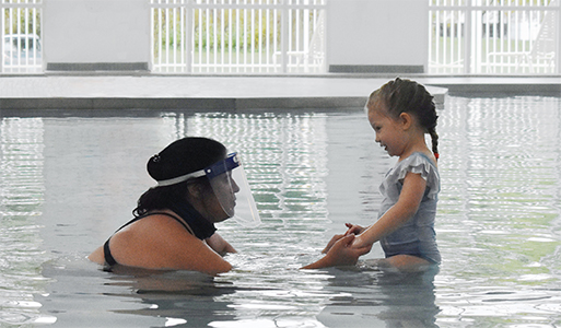 lifeguard and student in pool